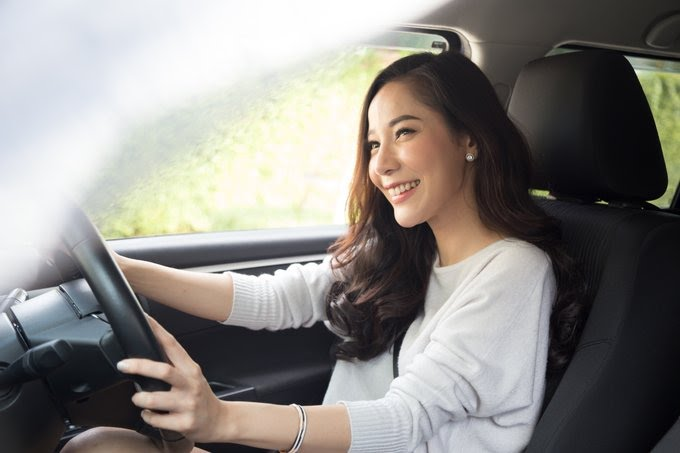 Asian Woman Driving in the Right Side